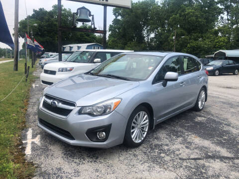 2013 Subaru Impreza for sale at BELL AUTO & TRUCK SALES in Fort Wayne IN
