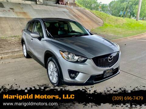 2014 Mazda CX-5 for sale at Marigold Motors, LLC in Pekin IL