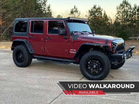 2011 Jeep Wrangler Unlimited for sale at Selective Imports in Woodstock GA