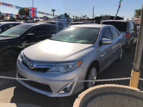 2012 Toyota Camry Hybrid for sale at Valley Auto Center in Phoenix AZ