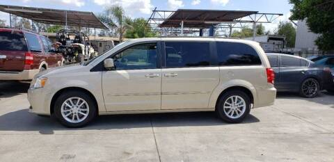 2014 Dodge Grand Caravan for sale at E and M Auto Sales in Bloomington CA