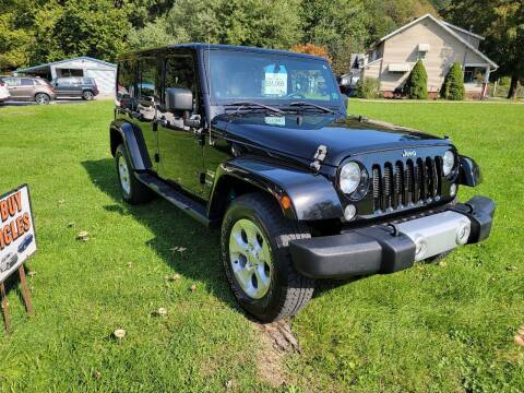 2014 Jeep Wrangler Unlimited for sale at A - K Motors Inc. in Vandergrift PA