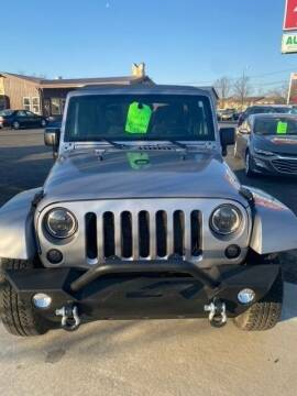 2017 Jeep Wrangler Unlimited for sale at Four Guys Auto in Cedar Rapids IA