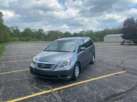 2009 Honda Odyssey for sale at Caruzin Motors in Flint MI