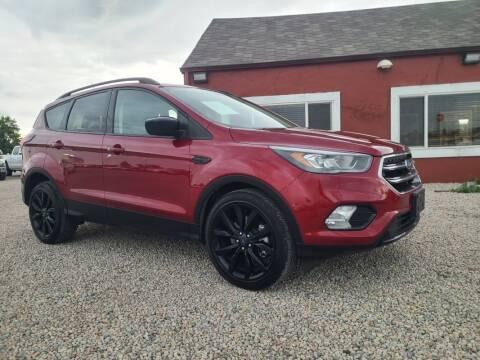 2019 Ford Escape for sale at BERKENKOTTER MOTORS in Brighton CO