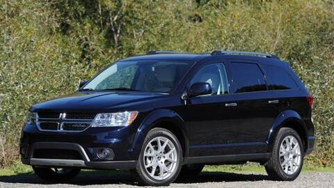 2011 Dodge Journey for sale at KHAN'S AUTO LLC in Worland WY