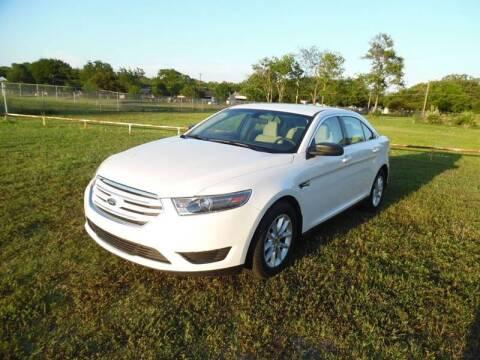 2014 Ford Taurus for sale at LA PULGA DE AUTOS in Dallas TX