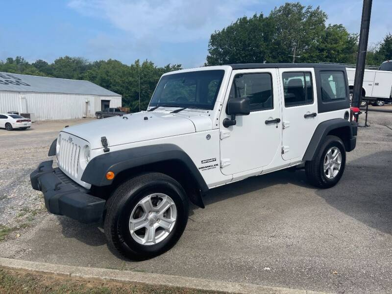 2013 Jeep Wrangler Unlimited for sale at Greg's Auto Sales in Poplar Bluff MO