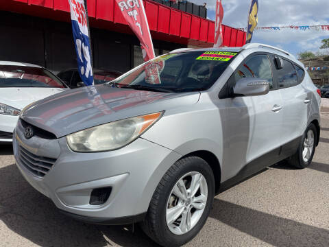2012 Hyundai Tucson for sale at Duke City Auto LLC in Gallup NM