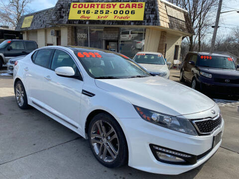 2013 Kia Optima for sale at Courtesy Cars in Independence MO
