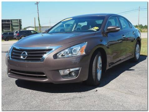 2014 Nissan Altima for sale at STRICKLAND AUTO GROUP INC in Ahoskie NC