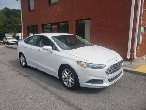 2013 Ford Fusion for sale at Credit Cars LLC in Lawrenceville GA