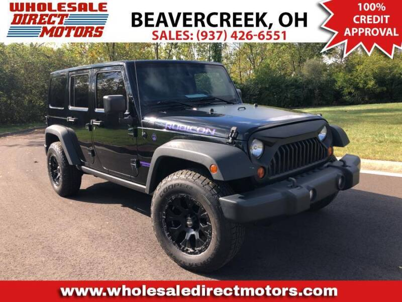 2011 Jeep Wrangler Unlimited for sale at WHOLESALE DIRECT MOTORS in Beavercreek OH