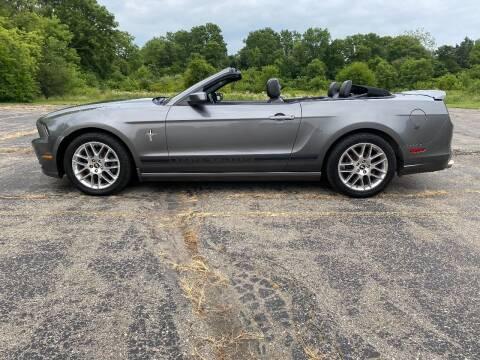2013 Ford Mustang for sale at Caruzin Motors in Flint MI