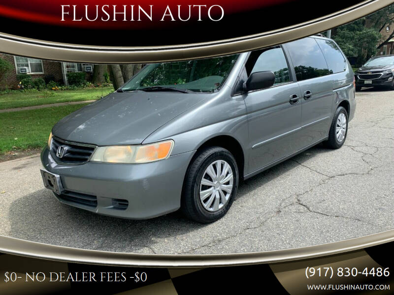 2002 Honda Odyssey for sale at FLUSHIN AUTO in Flushing NY