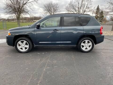 2007 Jeep Compass for sale at Caruzin Motors in Flint MI