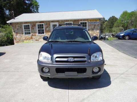 2005 Hyundai Santa Fe for sale at Flywheel Auto Sales Inc in Woodstock GA
