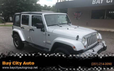 2007 Jeep Wrangler Unlimited for sale at Bay City Auto's in Mobile AL