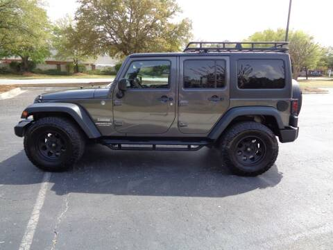 2014 Jeep Wrangler Unlimited for sale at BALKCUM AUTO INC in Wilmington NC