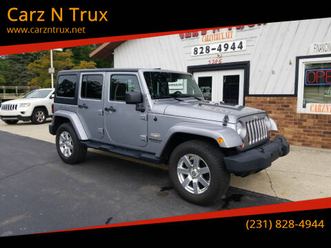 2013 Jeep Wrangler Unlimited for sale at Carz N Trux in Twin Lake MI