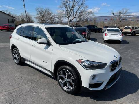 2018 BMW X1 for sale at MAGNUM MOTORS in Reedsville PA