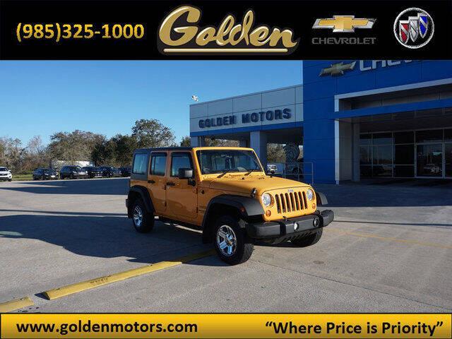 2012 Jeep Wrangler Unlimited for sale at GOLDEN MOTORS in Cut Off LA
