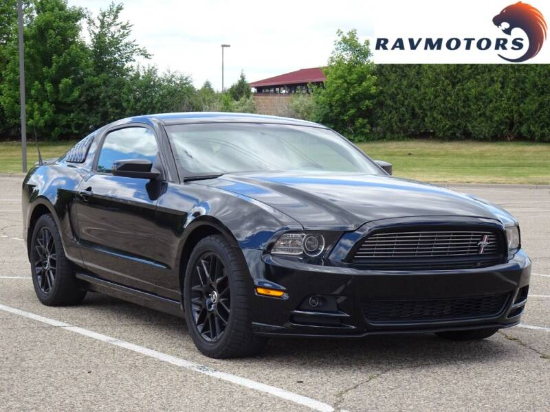 2014 Ford Mustang for sale at RAVMOTORS in Burnsville MN