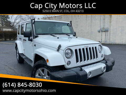 2013 Jeep Wrangler Unlimited for sale at Cap City Motors LLC in Columbus OH