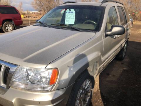 2004 Jeep Grand Cherokee for sale at BARNES AUTO SALES in Mandan ND