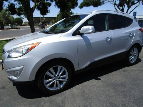 2012 Hyundai Tucson for sale at KM MOTOR CARS in Modesto CA