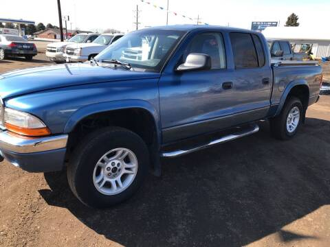 2002 Dodge Dakota for sale at BARNES AUTO SALES in Mandan ND