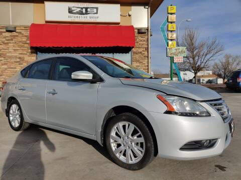 2013 Nissan Sentra for sale at 719 Automotive Group in Colorado Springs CO