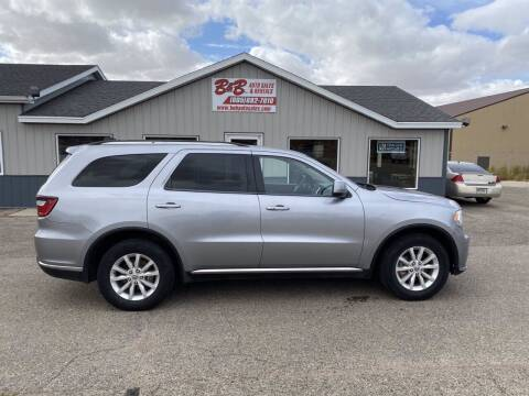 2014 Dodge Durango for sale at B & B Auto Sales in Brookings SD