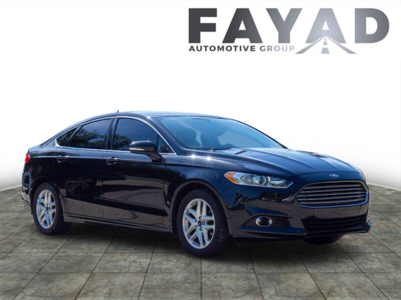 2015 Ford Fusion for sale at FAYAD AUTOMOTIVE GROUP in Pittsburgh PA