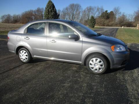 2011 Chevrolet Aveo for sale at Crossroads Used Cars Inc. in Tremont IL