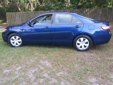 2009 Toyota Camry for sale at Royal Auto Mart in Tampa FL