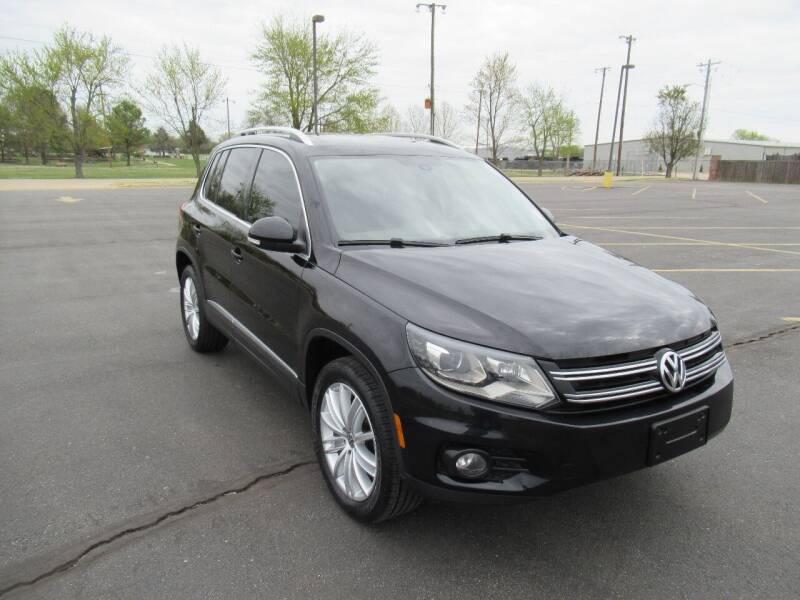 2016 Volkswagen Tiguan for sale at Just Drive Auto in Springdale AR