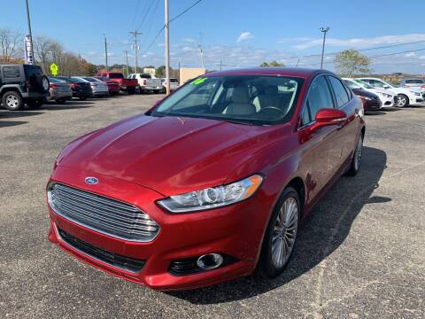 2016 Ford Fusion for sale at Carmans Used Cars & Trucks in Jackson OH