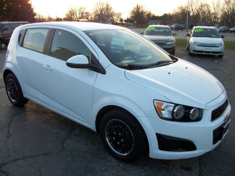 2014 Chevrolet Sonic for sale at USED CAR FACTORY in Janesville WI