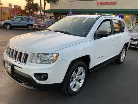2011 Jeep Compass for sale at La Mesa Auto Sales in Huntington Park CA