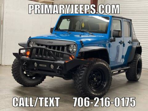 2011 Jeep Wrangler Unlimited for sale at Primary Auto Group in Dawsonville GA