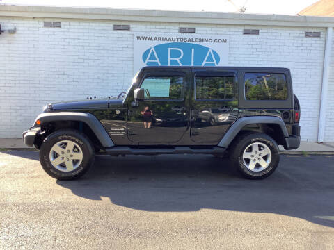 2012 Jeep Wrangler Unlimited for sale at ARIA  AUTO  SALES in Raleigh NC