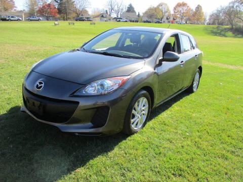 2012 Mazda MAZDA3 for sale at Triangle Auto Sales in Elgin IL