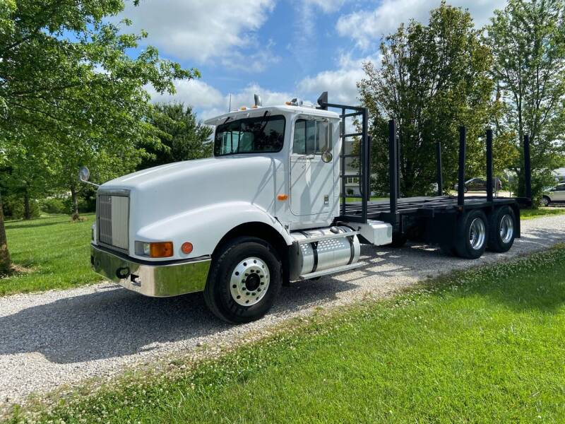 1992 International 9400 Twin Screw Logging Truck for sale at Ken's Auto Sales & Repairs in New Bloomfield MO