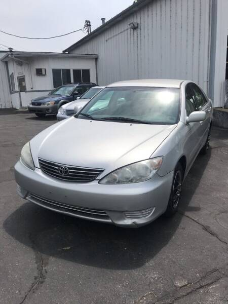 2006 Toyota Camry for sale at Riverside Garage Inc. in Haverhill MA