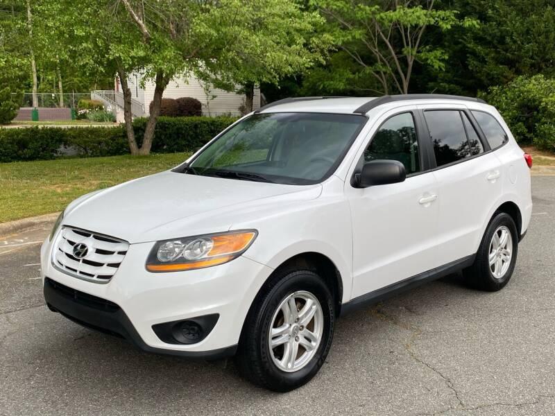 2011 Hyundai Santa Fe for sale at Triangle Motors Inc in Raleigh NC