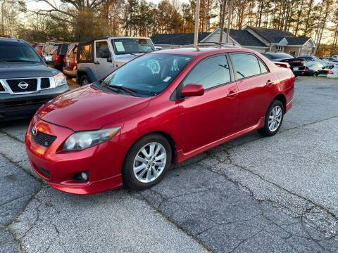 2009 Toyota Corolla for sale at Alpha Car Land LLC in Snellville GA