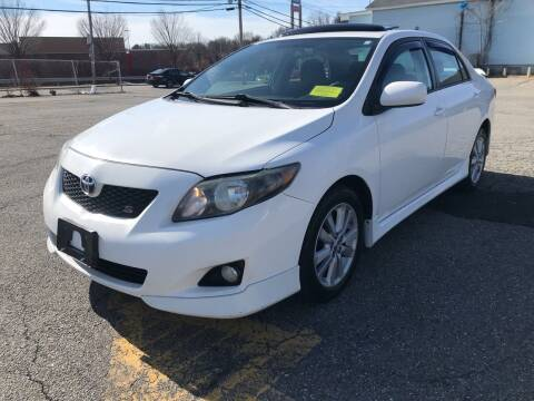 2009 Toyota Corolla for sale at D'Ambroise Auto Sales in Lowell MA