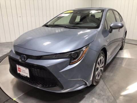 2020 Toyota Corolla Hybrid for sale at HILAND TOYOTA in Moline IL