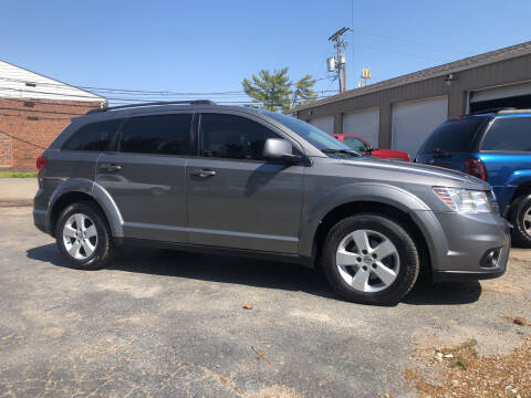 2012 Dodge Journey for sale at Jim's Hometown Auto Sales LLC in Byesville OH